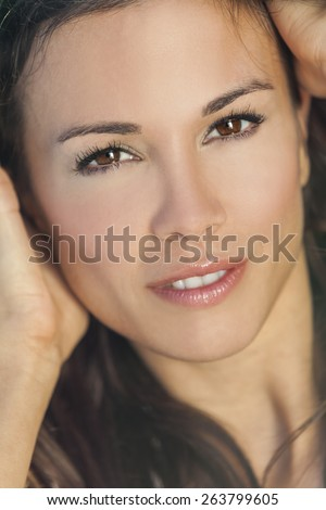 Portrait of a smiling beautiful brunette young woman or girl with brown eyes - stock photo