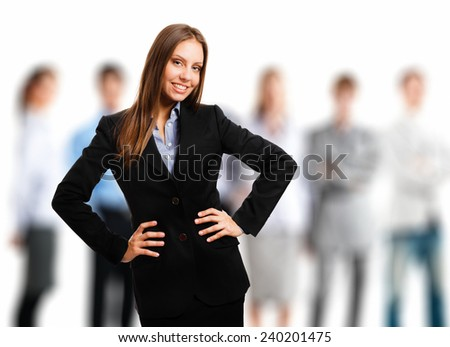 Portrait of a smiling beautiful businesswoman in front of her team
