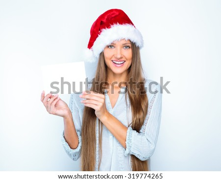 portrait of a smiling beautiful happy girl in christmas santa hat. beauty woman. isolated on white background. happy new year 2016. - stock photo