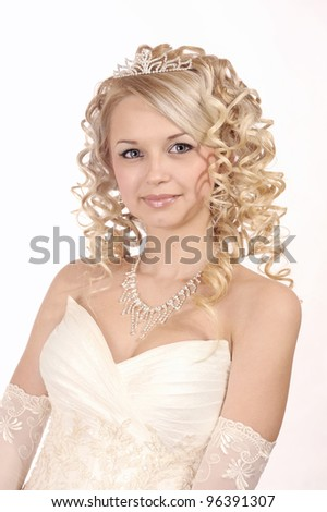 Portrait of a smiling beautiful woman dressed as a bride isolated on white background.