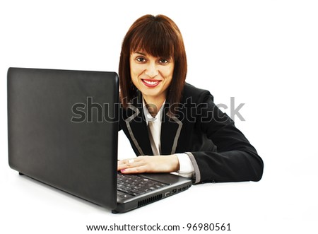 Portrait of a smiling beautiful young business woman working on laptop.  Isolated on white background. - stock photo
