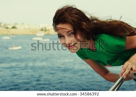 portrait of a smiling beautiful young woman - stock photo