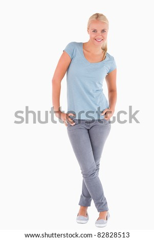 Portrait of a smiling blond woman in a studio - stock photo