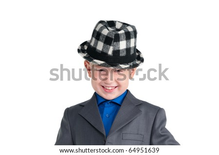 Portrait of a smiling boy in suit with chequered black and white hat