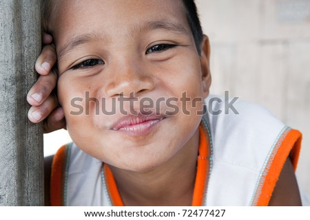 Portrait of a smiling boy in the Philippines from an impoverished neighborhood. - stock photo