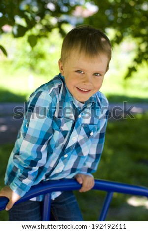 Portrait of a smiling boy of five years - stock photo