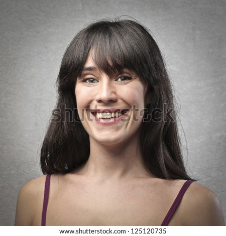 Portrait of a smiling brown woman - stock photo