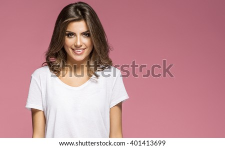Portrait of a smiling brunette woman - stock photo