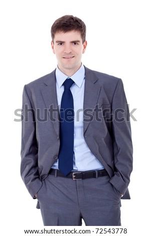 Portrait of a smiling business man standing with his hands in the pockets - stock photo