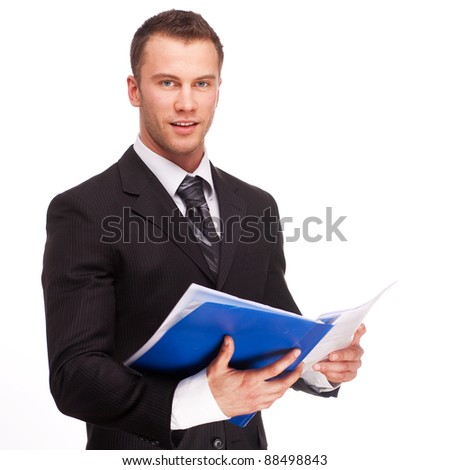 Portrait of a smiling business man with documents isolated on white background. Studio shot. - stock photo