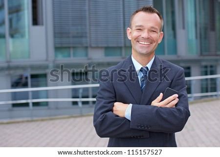 Portrait of a smiling business man with his arms crossed