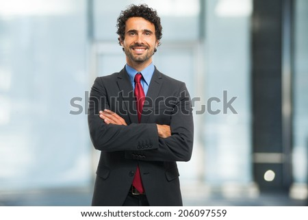 Portrait of a smiling businessman - stock photo