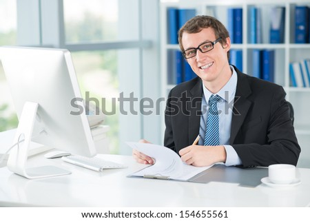 Portrait of a smiling businessman at work on the foreground