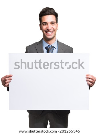 Portrait of a smiling businessman holding a white board