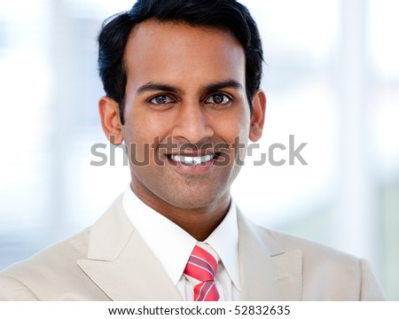 Portrait of a smiling businessman in the office - stock photo