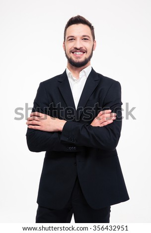 Portrait of a smiling businessman standing with arms folded isolated on a white background