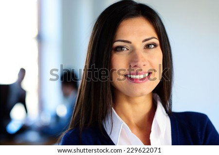 Portrait of a smiling businesswoman - stock photo