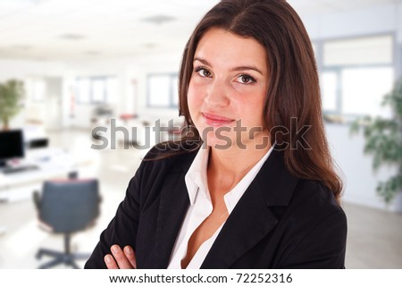 Portrait of a smiling businesswoman in an office environment. - stock photo