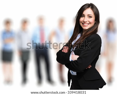 Portrait of a smiling businesswoman with colleagues in the background