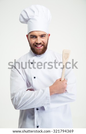 Portrait of a smiling chef cook holding spoon isolated on a white background - stock photo