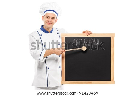 Portrait of a smiling chef pointing on a board isolated on white background - stock photo