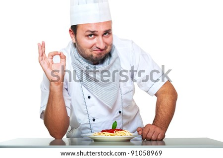 Portrait of a smiling chef preparing dinner - stock photo