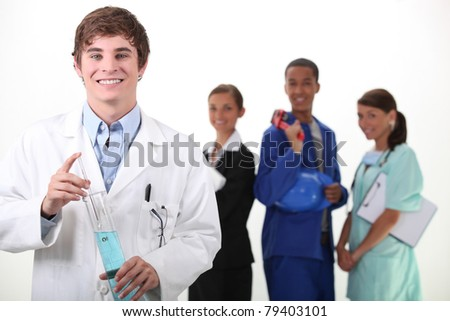 Portrait of a smiling chemist and different workers