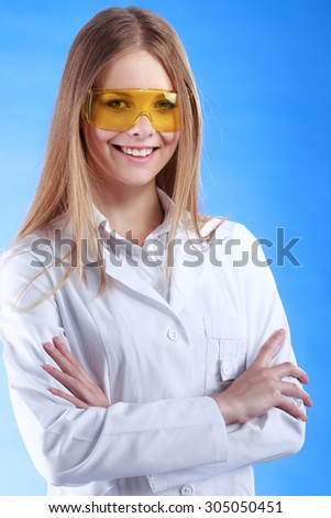 Portrait of a smiling chemist with arms crossed - stock photo