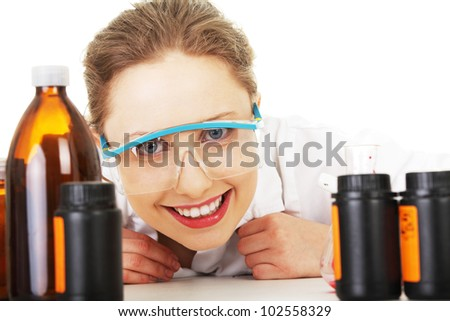 Portrait of a smiling chemist working at laboratory - stock photo
