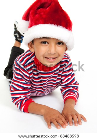 Portrait of a Smiling Child Wearing Santa Hat on White - stock photo