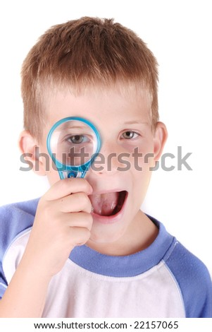 Portrait of a smiling child with loupe isolated white background