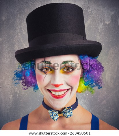 Portrait of a smiling clown and colorful - stock photo