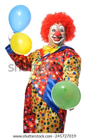 Portrait of a smiling clown with balloons isolated on white - stock photo