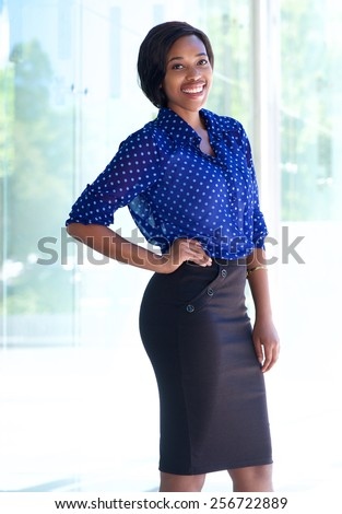 Portrait of a smiling confident business woman standing outdoors - stock photo