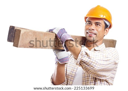 Portrait of a smiling construction worker carrying pieces of lumber. Isolated in white background. - stock photo