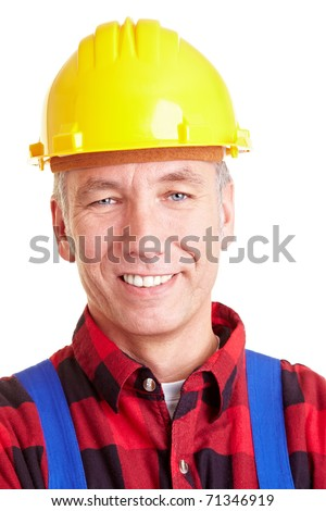 Portrait of a smiling construction worker with hard hat - stock photo