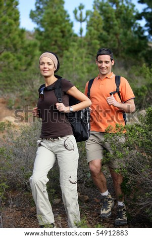 Portrait of a smiling couple hiking - stock photo