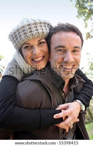 Portrait of a smiling couple in the countryside - stock photo