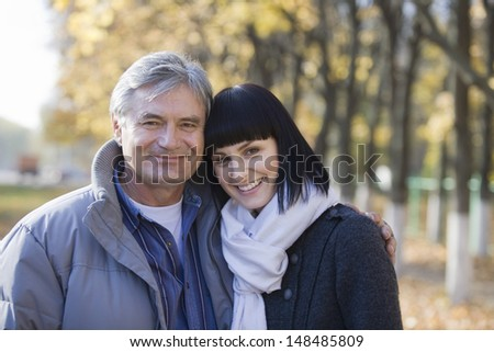 Portrait of a smiling couple in the park - stock photo
