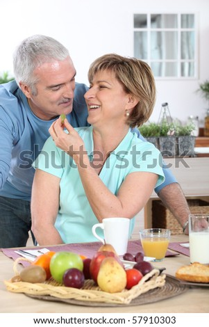Portrait of a smiling couple of retirees at breakfast