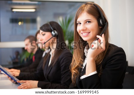 Portrait of a smiling customer representative at work - stock photo
