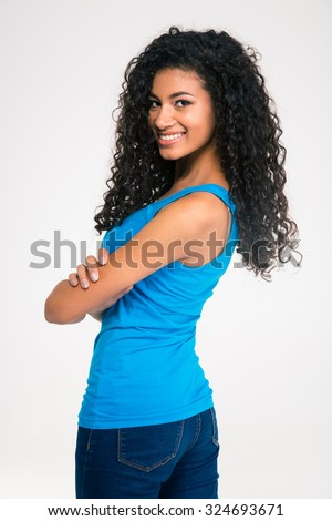 Portrait of a smiling cute afro american woman looking back at camera isolated on a white background - stock photo