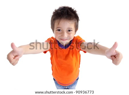 Portrait of a smiling cute little boy gesturing thumbs up sign against white background