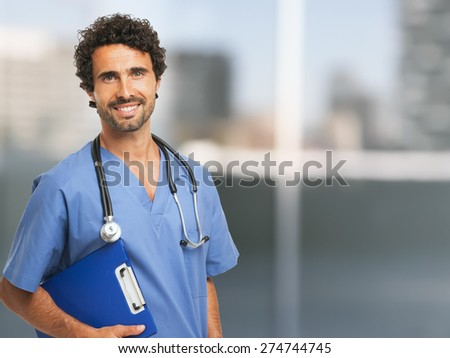 Portrait of a smiling doctor - stock photo