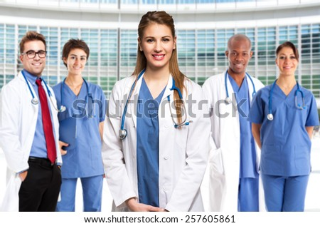 Portrait of a smiling doctor in front of her medical team