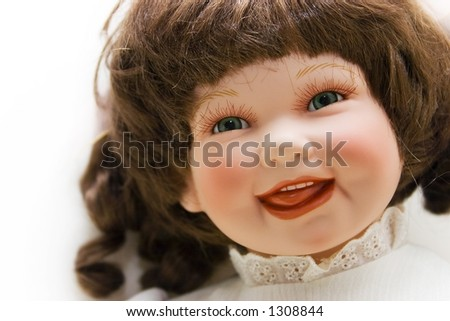Portrait of a smiling doll - stock photo
