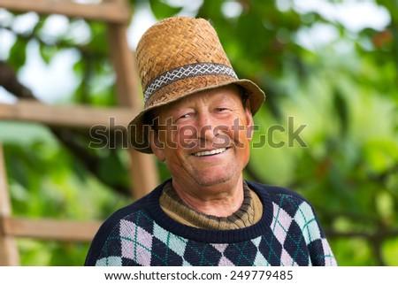 Portrait of a smiling elderly man - stock photo