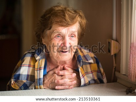 Portrait of a smiling elderly woman. - stock photo