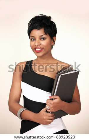 Portrait of a smiling ethnic college girl holding notes and files - stock photo