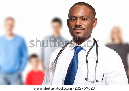 Portrait of a smiling family doctor - stock photo